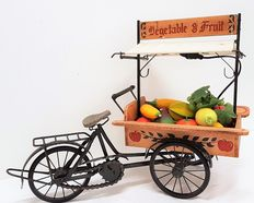 Vegetables and fruit delivery bicycle with lighting