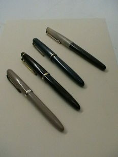 A collection of 4 fountain pens.