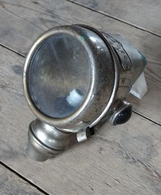 An antique Alerio (motor)bike headlight - Spain - ca. 1900-1930