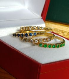 Four 18 kt gold half-wedding rings with diamonds, emeralds, and sapphires - size 50