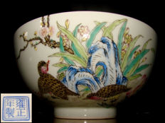 A large porcelain bowl with partridges among rocks, blossoms and twigs - China - 2nd Second half of 20th  century