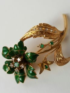 Floral polychromy brooch in gold, green enamel and precious stones