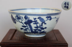 Porcelain bowl with birds and blossoms in blue and white paint. China - probably 17th century (Ming period)