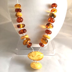 Baltic amber of 100% natural very large beads in various colours- 15-27mm, 67 grams
