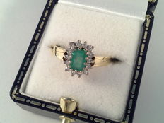 Ring, 18 karat yellow and white gold, with emerald and 14 diamonds, 0.35 ct