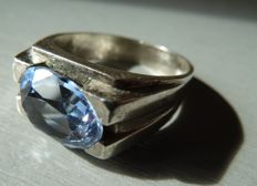 Ring in solid silver set with a large blue topaz