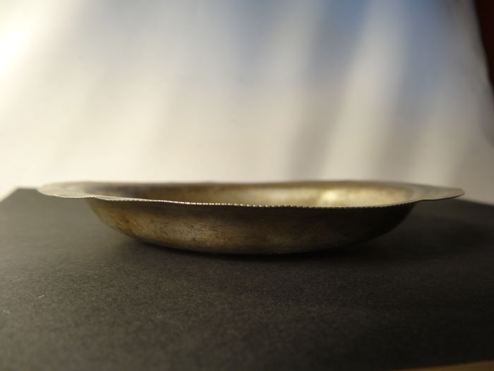 Silver bowl with coin bottom