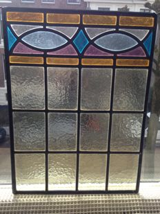 Jugendstil window panel with soft colours in stained glass with mosaic, in good used condition.