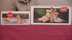 2 Coca cola tin advertising posters - late 20th/early 21st century