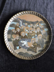 Large Satsuma ware wall plate with a depiction of men, Japan, circa 1920
