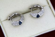 White gold earrings with 2 sapphires and paved with diamonds.