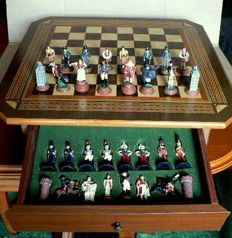 Collection chess of hand-painted lead. Furniture-board made of fine woods.