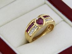 Gold Ring with Heart-Shaped Ruby, Calibrated Rubies and Diamonds.