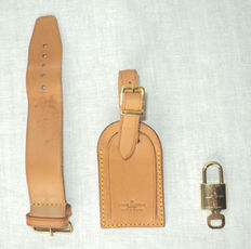 3 Louis Vuitton Accessories: Name & Address Tag, Handle Strap Holder and LV Padlock with Key.