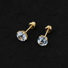 Yellow gold earrings in stud style, with 2  aquamarine gemstones weighing 0.92 ct in  prong settings.
