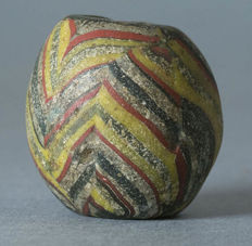An ancient morfia glass bead -  Islamic era, made in Fustat (Cairo)
