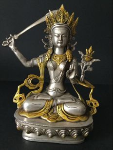 Silver-plated and gilt copper depiction of the Bodhisattva Manjushri – Nepal – Early 21st century