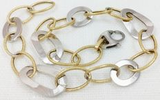 Bracelet composed of links in 18 kt (750/1000) white and yellow gold.