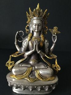 Depiction of Bodhisattva Chenrezig in Silver-Plated Copper and Gilt - Nepal - Beginning of 21st Century.