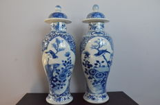 Two B/W lidded vases decorated with flowers and birds – China – 19th century