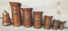 Lot with seven authentic measuring cups
