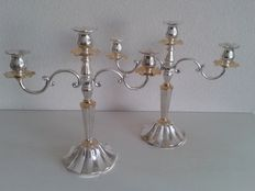 Set of silver plated 3-light candle stands with gilded elements, 2nd half 20th century
