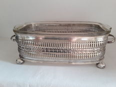 The glass baking dish comes with a silver plated holder