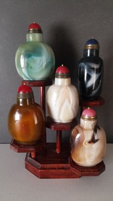 Display with seven, different, agate, snuff bottles - China - late 20th century.