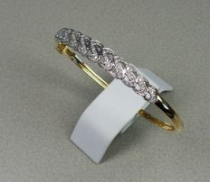 14 kt gold bangle with 60 diamonds