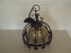 Vintage hanging lamp with a cast iron cover.
