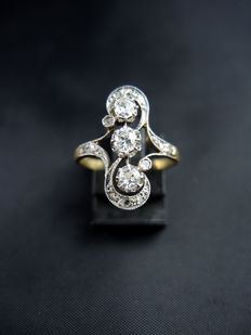 Antique You & Me ring set with diamonds.