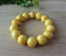 Baltic amber bracelet  milk honey colour with marble effect, 31.24 gr.