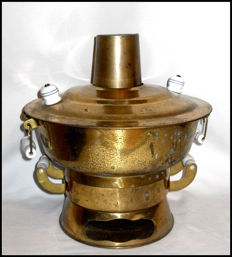 Brass samovar with undercarriage.