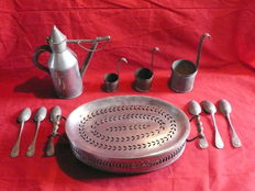 Iron and tin items - dish-warmer, measuring cups, spoons - late 19th century
