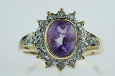 Gold 14 karat, entourage ring set with amethyst and diamonds.