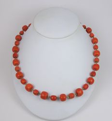 Necklace of large red corals strung on gold