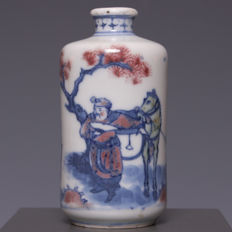 Beautiful under-glaze red and blue and white decorated porcelain snuff bottle – human figures with horse – China – first half 20th century