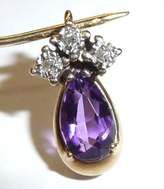 Pendant with amethyst drop and 3 diamonds made of 333 / 8 kt gold