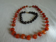 Garnet bracelet with gold clasp and carnelian necklace with base metal clasp