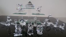Swarovski - 14 figurines and a facet stone from various series