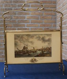 Brass magazine rack with engraved ships