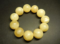 Baltic amber bracelet in yellow/ white colour, 55 grams