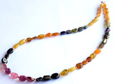 Necklace made of multi-colour tourmaline beads, with 585/1000 gold clasp as well as 585/1000 beads in between.