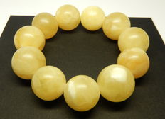 Baltic Amber bracelet in yellow, white colour, 55 grams