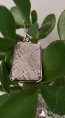 "Unique pendant made of a piece of ""Seymchan"" meteorite"