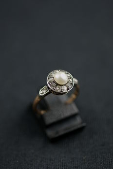 Antique real pearl ring with diamond entourage