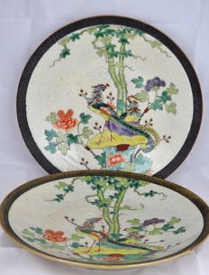 A Pair Large Nanking polychrome decorated porcelain plates with phoenixes – China – ca. 1900