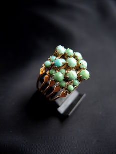 Ancient harem ring adorned with turquoise
