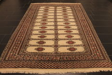 Magnificent hand-knotted Oriental carpet Buchara Jomut. 190 x 270 cm. Made in Pakistan, mid of the 20th century.