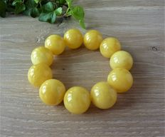 Baltic Amber bracelet in egg yolk/ butter colour, 49.38 gr